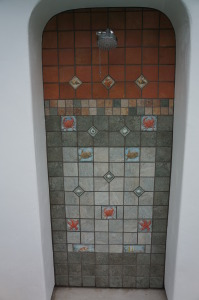 Tile work done by Kim Stoddard with animal tiles by Margaret Licha.